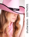 Portrait of a beautiful woman wearing pink cowboy's hat - stock photo