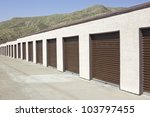 Brown storage units in a long strip row. - stock photo