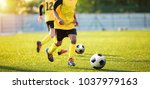 football training on the pitch. ... | Shutterstock . vector #1037979163