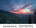 mystical sunset over the...   Shutterstock . vector #1037987053