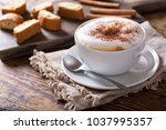 cup of cappuccino coffee on... | Shutterstock . vector #1037995357