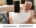 a young cute fat man with... | Shutterstock . vector #1038039547