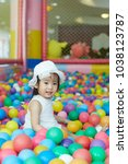 little asian girl having fun at ...   Shutterstock . vector #1038123787