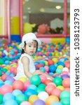 little asian girl having fun at ...   Shutterstock . vector #1038123793