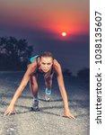 sprinter woman on the start ... | Shutterstock . vector #1038135607