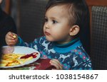 child eating fries with your... | Shutterstock . vector #1038154867