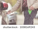 man entering his car and... | Shutterstock . vector #1038169243