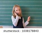 a first grade student at school ... | Shutterstock . vector #1038178843