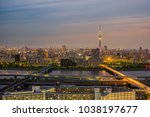 tokyo cityscape at sunset in... | Shutterstock . vector #1038197677