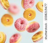 falling or flying pink glazed... | Shutterstock . vector #1038215677