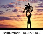 silhouette of a disabled man... | Shutterstock . vector #1038228103