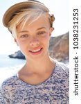 portrait of young male on rocky ... | Shutterstock . vector #1038231253