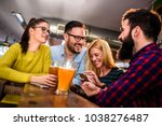 friends in pub drinking beer... | Shutterstock . vector #1038276487