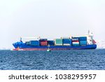 Container Cargo Ship At The Sea