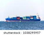 container cargo ship at the sea   Shutterstock . vector #1038295957