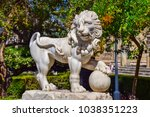 a lion sculpture with a claw... | Shutterstock . vector #1038351223