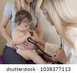 pediatrician examines baby .... | Shutterstock . vector #1038377113
