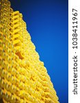 Small photo of New yellow wooden formwork stacked in a warehouse in large piles. Materials for the construction and erection of concrete structures. Abstract background, soft focus and beautiful bokeh.