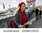 enthusiastic female traveler in ... | Shutterstock . vector #1038413653