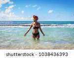 black woman on the beach at... | Shutterstock . vector #1038436393