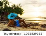 woman on the tropical beach of... | Shutterstock . vector #1038539383