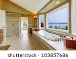 Large bath tun with water view and luxury bathroom interior in beige colors. - stock photo