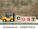 yellow toy forklift hold letter ... | Shutterstock . vector #1038576913