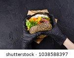 woman's hands in black rubber... | Shutterstock . vector #1038588397
