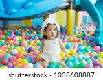 asian little girl playing blue...   Shutterstock . vector #1038608887