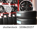 car tires and alloy wheels in... | Shutterstock . vector #1038620257