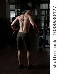 athlete working out shoulders... | Shutterstock . vector #1038630427