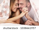 adult attractive couple in bed | Shutterstock . vector #1038661957
