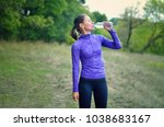 a caucasian athletic  woman in... | Shutterstock . vector #1038683167