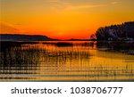 sunset lake landscape | Shutterstock . vector #1038706777