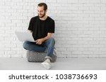 young man using laptop indoors   Shutterstock . vector #1038736693