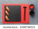 salmon sushi on black slate... | Shutterstock . vector #1038738523