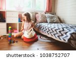 child girl cleaning her room... | Shutterstock . vector #1038752707