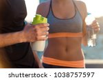 toned belly of fit woman.... | Shutterstock . vector #1038757597