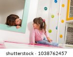 mother and daughter playing in... | Shutterstock . vector #1038762457