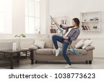 happy woman cleaning home ... | Shutterstock . vector #1038773623