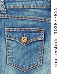 Close-up blue denim with pocket and button. - stock photo
