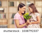 happy child daughter and mother | Shutterstock . vector #1038792337