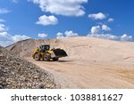 Small photo of heavy construction machine in open-cast mining - wheel loader transports gravel in a gravel plant
