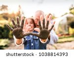 senior man with granddaughter...   Shutterstock . vector #1038814393