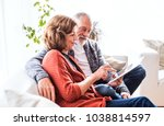 senior couple with tablet... | Shutterstock . vector #1038814597