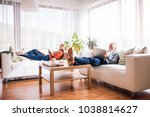 senior couple with tablet and... | Shutterstock . vector #1038814627