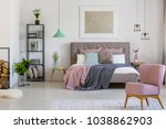 pink armchair and double bed in ... | Shutterstock . vector #1038862903