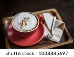 coffee latte on table in cafe... | Shutterstock . vector #1038885697