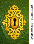 Antique golden keyhole - stock photo