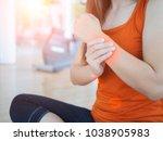 young woman massaging her wrist ...   Shutterstock . vector #1038905983